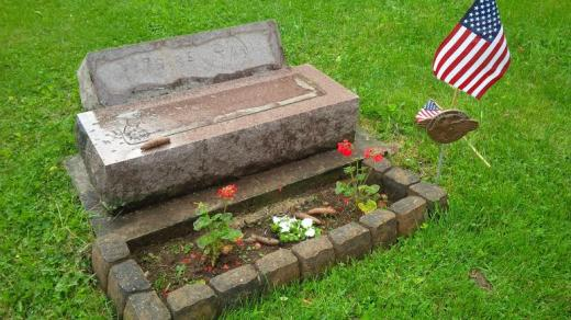 Police Charge Man with Cemetery Vandalism, Burning American Flag