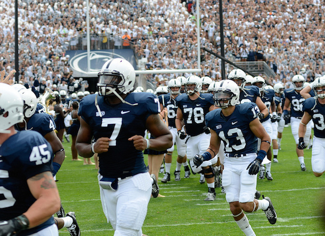 Football Players to Hit the Streets of State College for Poster Blitz