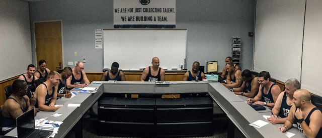 Penn State Football Coaches Wear Singlets to Congratulate Wrestling Team