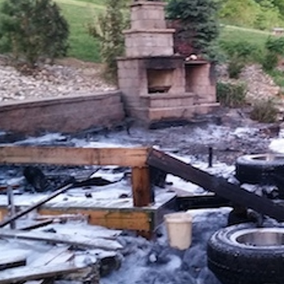 Flames Destroy Backyard Deck, Menace Home, Alert Neighbors Save the Day