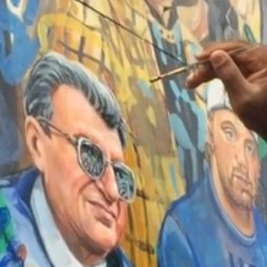 Pilato Paints Back Halos to Inspiration Mural