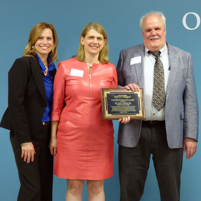 Local optometrist honored for service