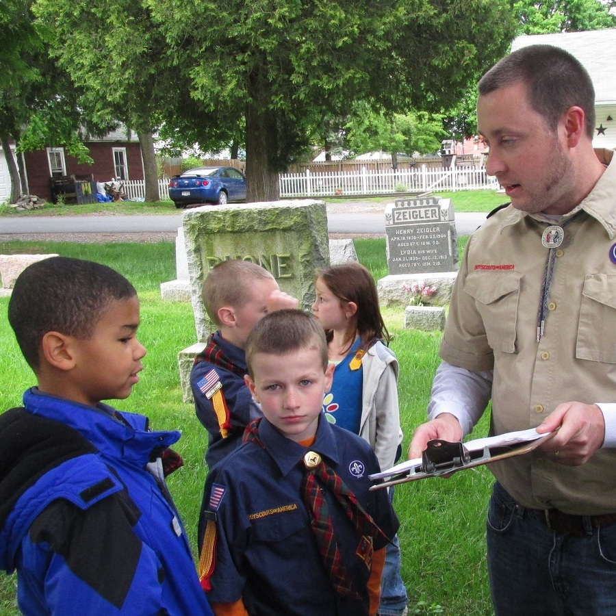 Cub Scouts replace flags on Veterans' graves