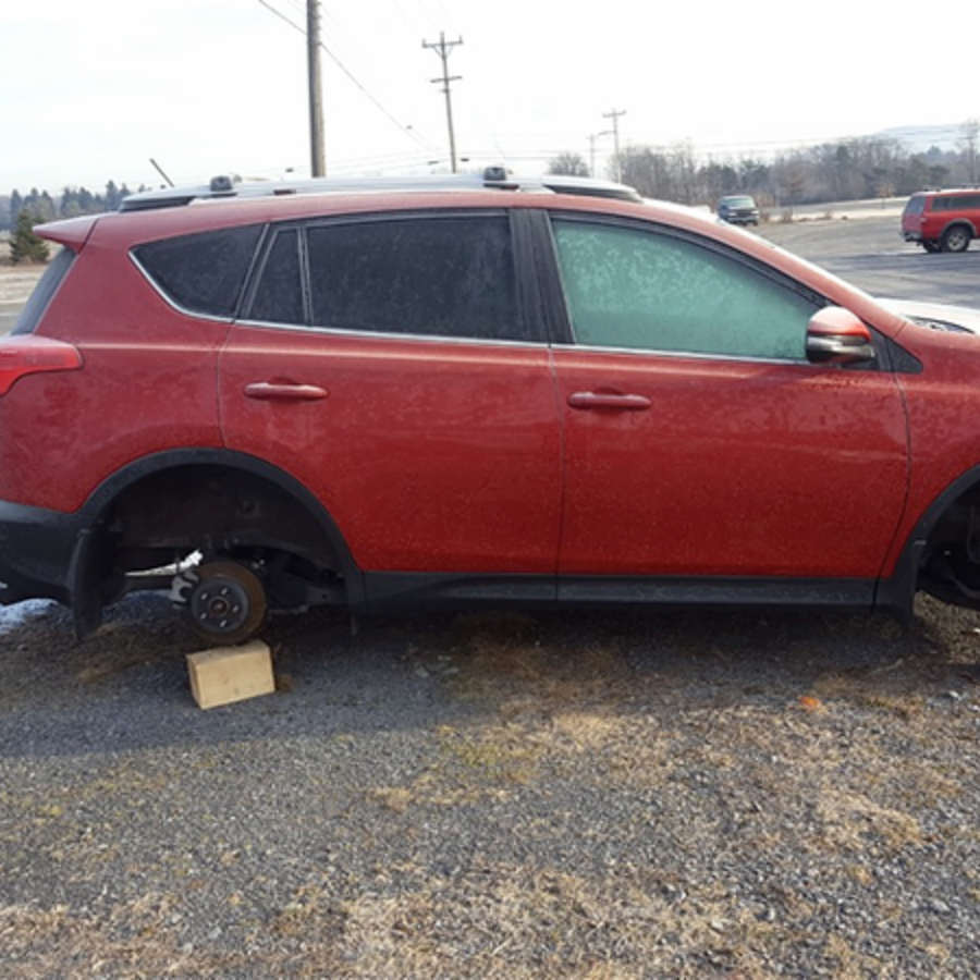 Tires and Wheels Stolen from Vehicle
