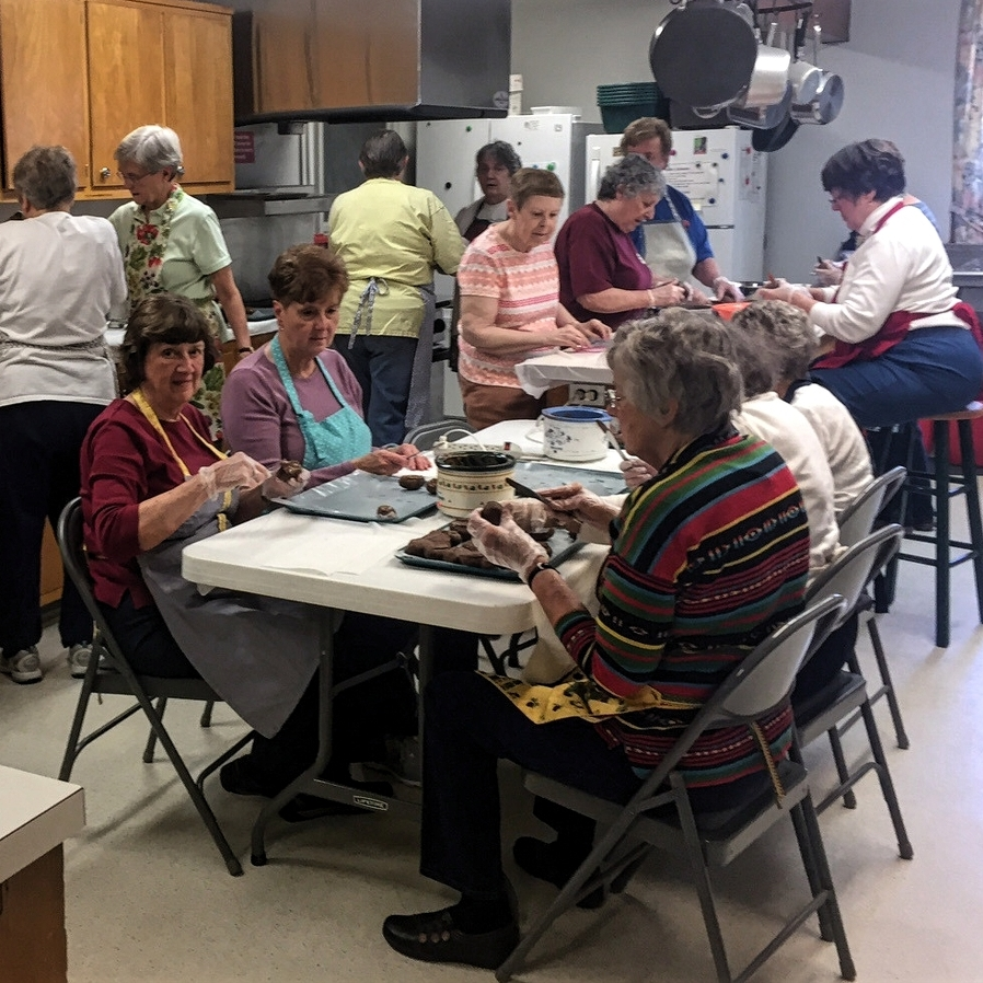 Creating chocolate Easter eggs a Park Forest UMC tradition in State College