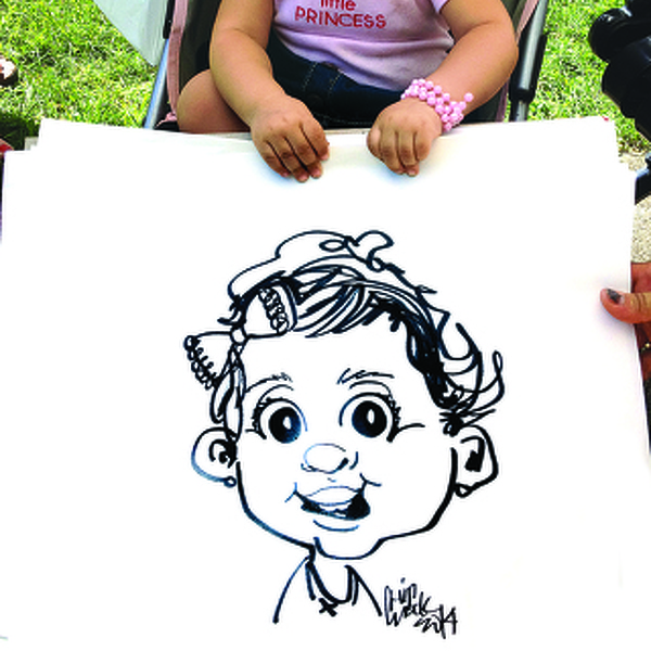 Caricature Artist Continues to Capture Likenesses at Fair