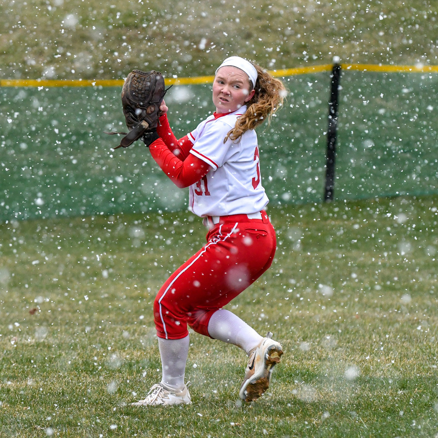 Softball teams battle opponents and Mother Nature