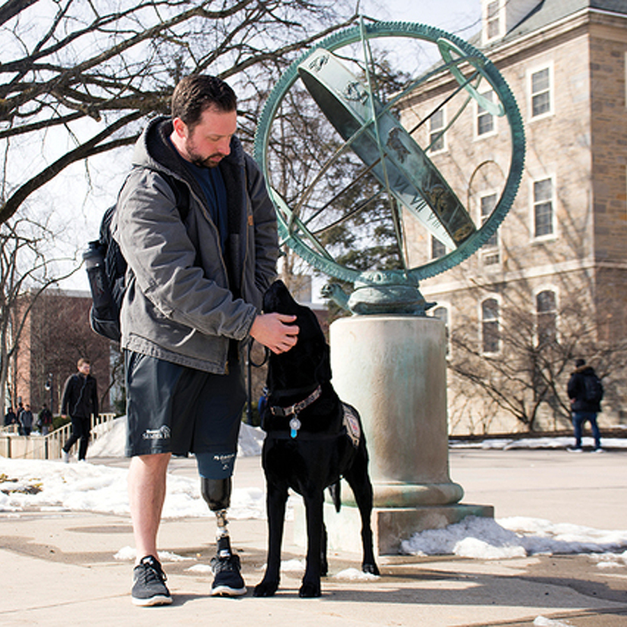 Navy Veteran, Wounded in Combat, and His Service Dog Are Inseparable on Penn State's Campus