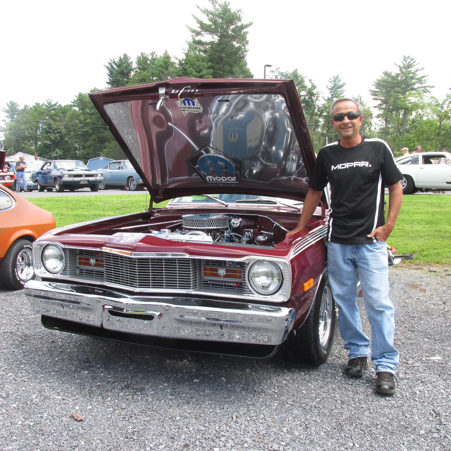 Car enthusiasts show off vehicles at free event