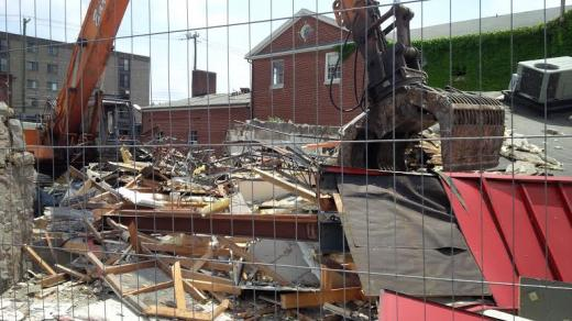 Demolition Underway at Former Arby's Site to Make Room for Metropolitan Building