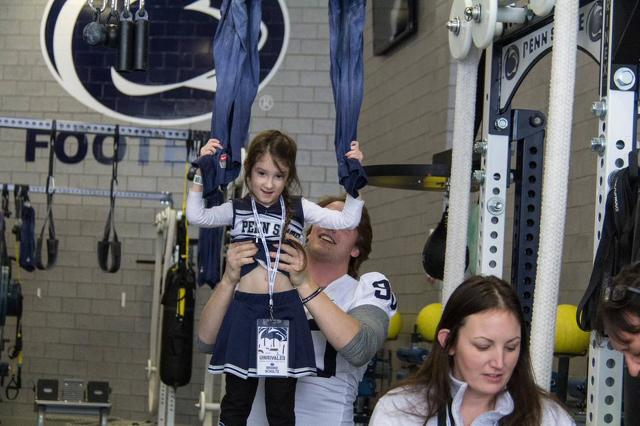 Football Team Hosts THON Families in Lasch Building