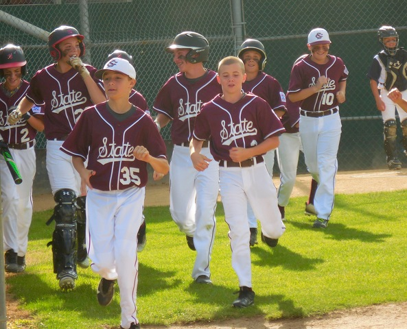 3e5ec98b70 State College players return to dugout after celebrating Luke Janac s home  run. From left are Evan Summerson