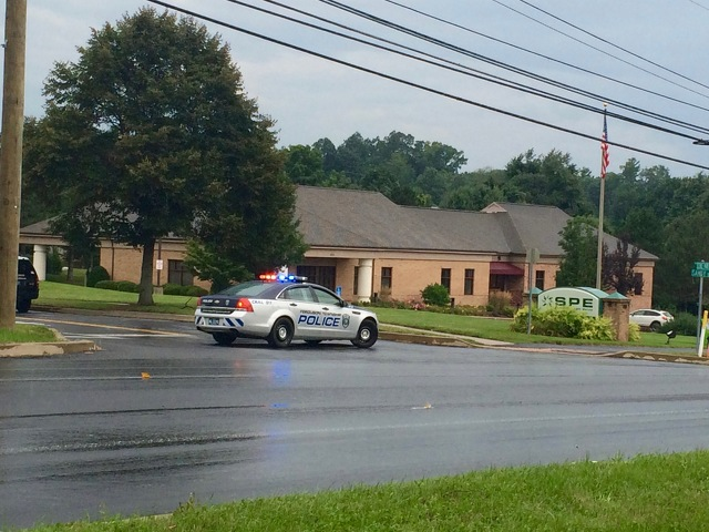 Police Investigating Robbery, Bomb Threats