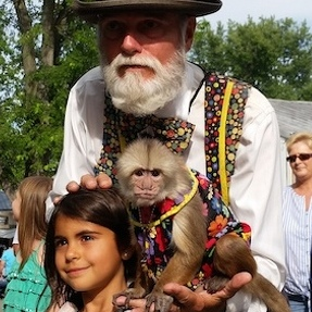 The Monkey Man Draws Big Following at Grange Fair