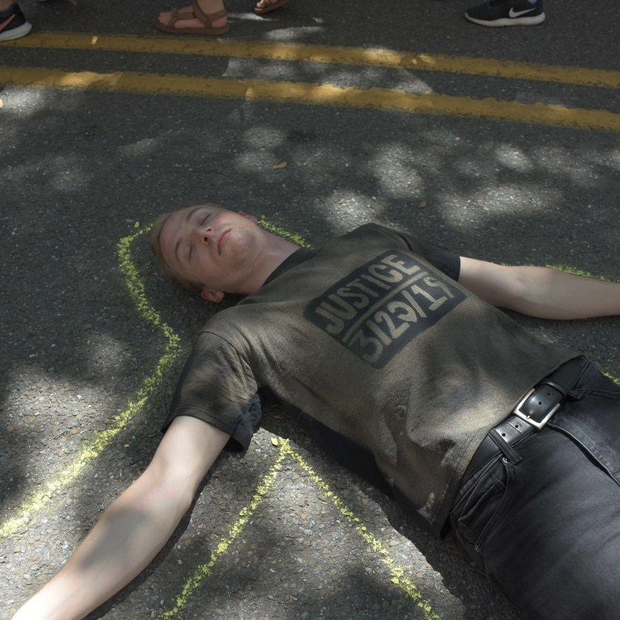 Osagie Protestors Lie in Front of State College Municipal Building During Arts Fest