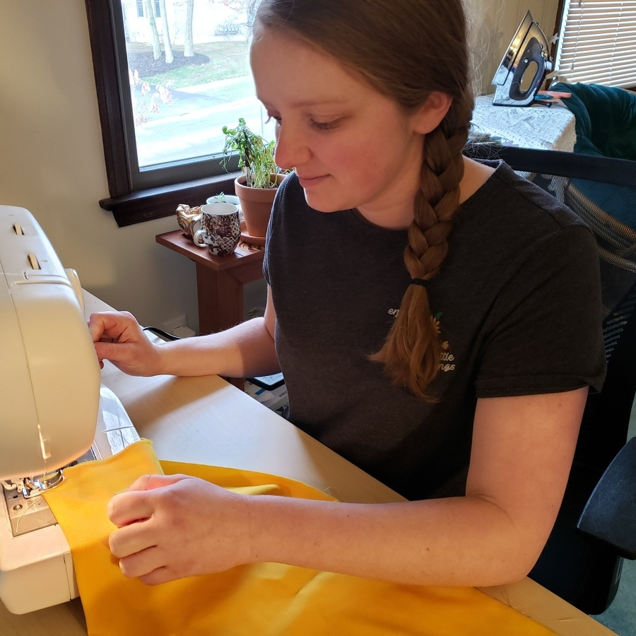 Seamstresses stitching masks for medical community
